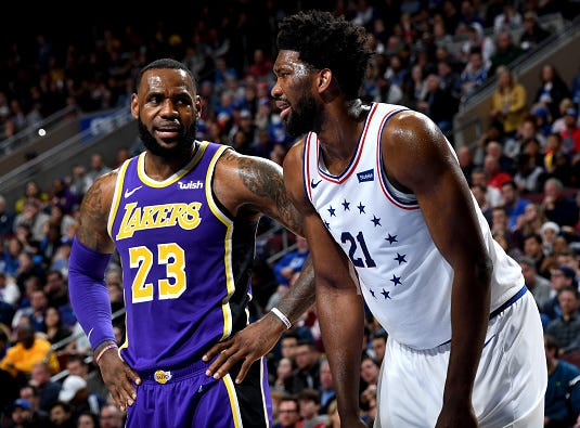 LeBron James #23 of the Los Angeles Lakers talks with Joel Embiid #21 of the Philadelphia 76ers during the game on February 10, 2019 at the Wells Fargo Center in Philadelphia.