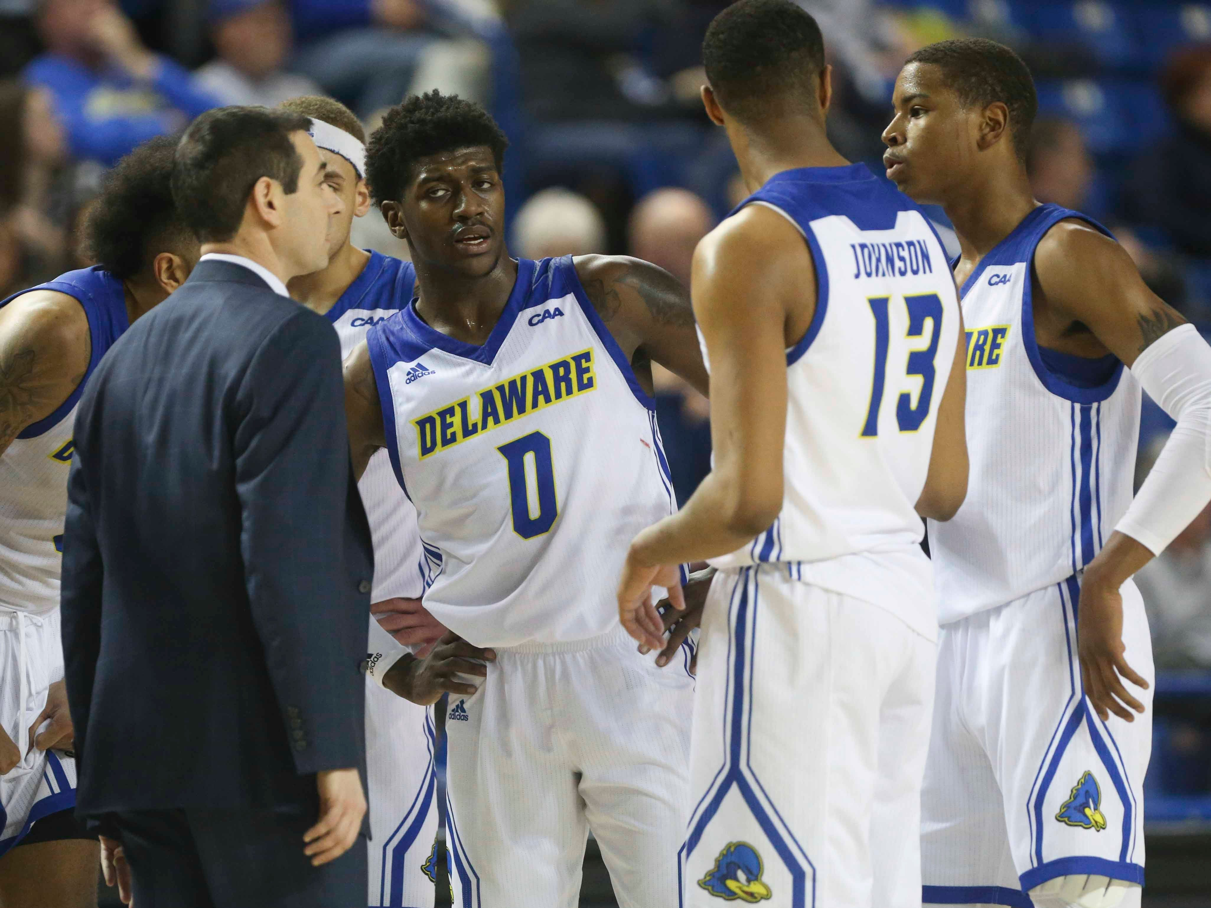 Delaware head coach Martin Ingelsby gets his team, including (from left) Ryan Allen, Ryan Johnson and Kevin Anderson together late in the second half of Delaware's 70-66 win at the Bob Carpenter Center Saturday.