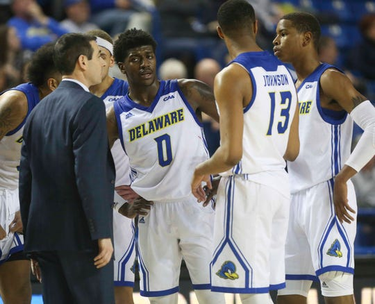 Delaware head coach Martin Ingelsby gets his team, including (from left) Ryan Allen, Ryan Johnson and Kevin Anderson together late in the second half of Delaware's 70-66 win over UNCW recently.