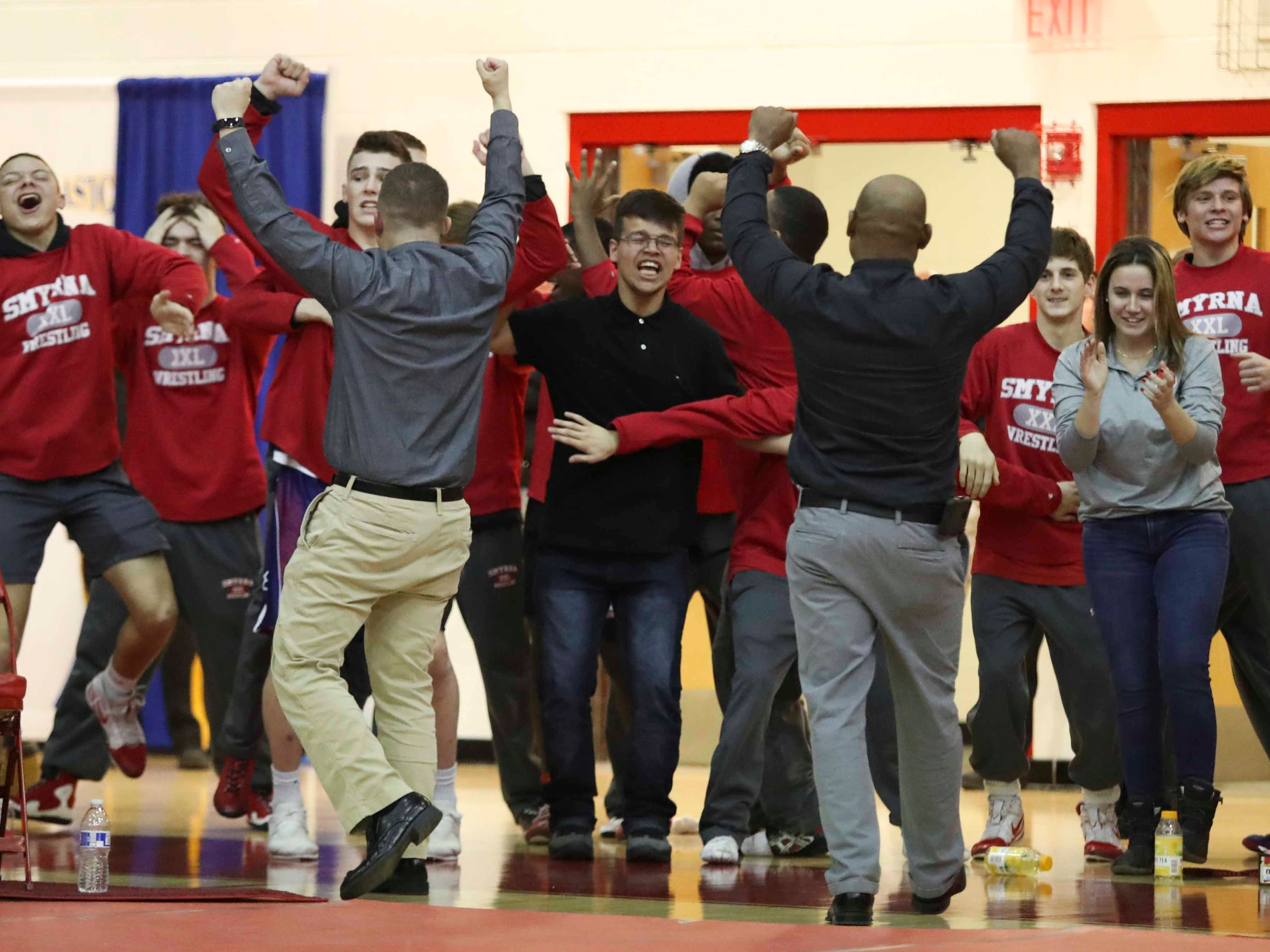 Smyrna cheers after winning the Division I in the DIAA dual meet championship in the final round versus Caesar Rodney Saturday at Smyrna High School.