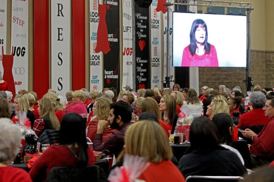 Attendees watch a video of Sherry Hitchcock medical experience during Heart of a Woman Saturday, Feb. 9, 2019, in the Ray Clymer Exhibit Hall.