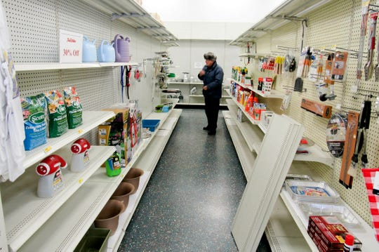 In this Jan. 22, 2019, photo Mike Hausmann, who owned the Poynette True Value Hardware store from 1994 to 2004, looks over the dwindling inventory at the store, which is going out of business, in Poynette, Wis.
