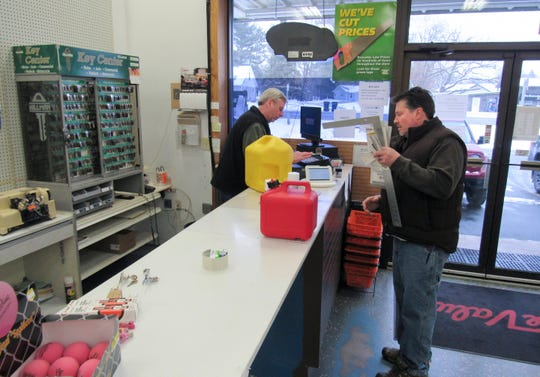 In this Jan. 22, 2019, photo Randy Schultz, left, owner of the store, checks out the purchases made by Shaun Lapacek, co-owner of Rock N Wool Winery just north of the village, at True Value Hardware in Poynette, Wis.