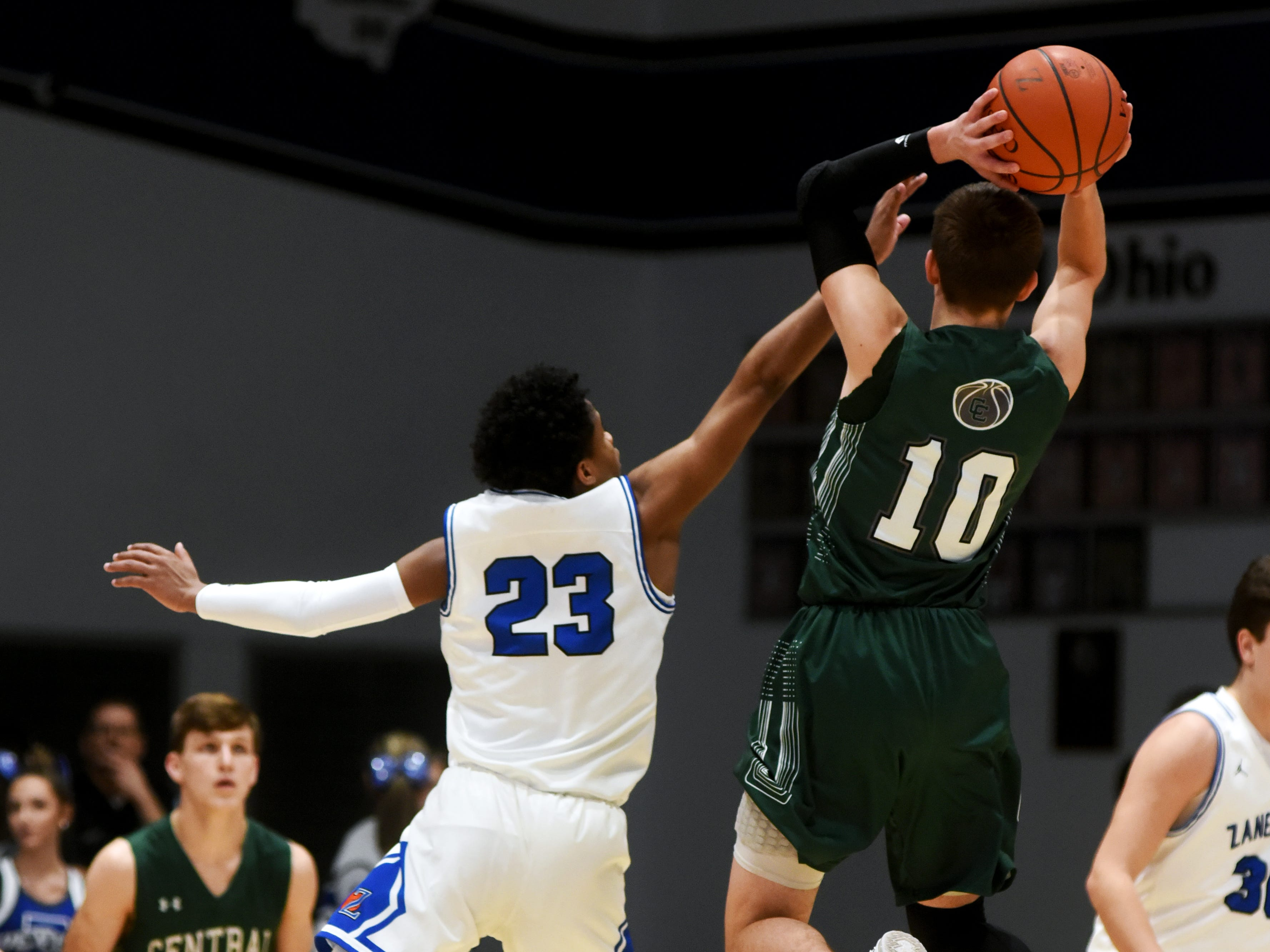 Zanesville's Greg Gibson, left, goes up to block a shot against Canton Central Catholic's Dylan Johnson.