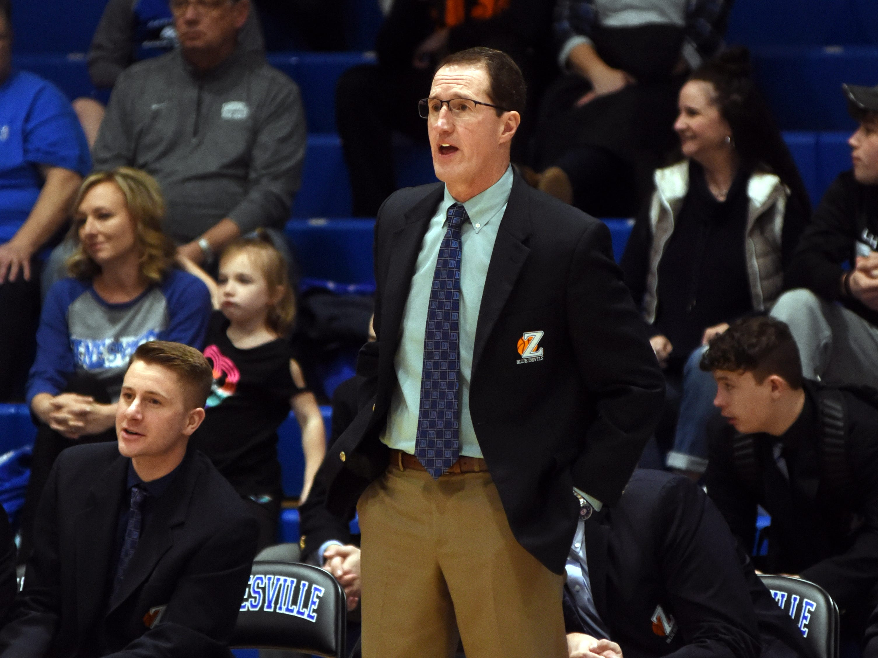 Zanesville coach Scott Aronhalt yells out instructions against Canton Central Catholic.