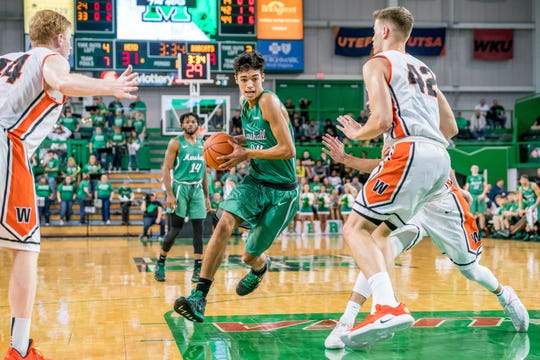 Zanesville graduate Cameron Brooks-Harris drives into the lane for Marshall during his freshman year against West Virginia Wesleyan. Brooks-Harris has entered the transfer portal after his scholarship wasn't renewed.