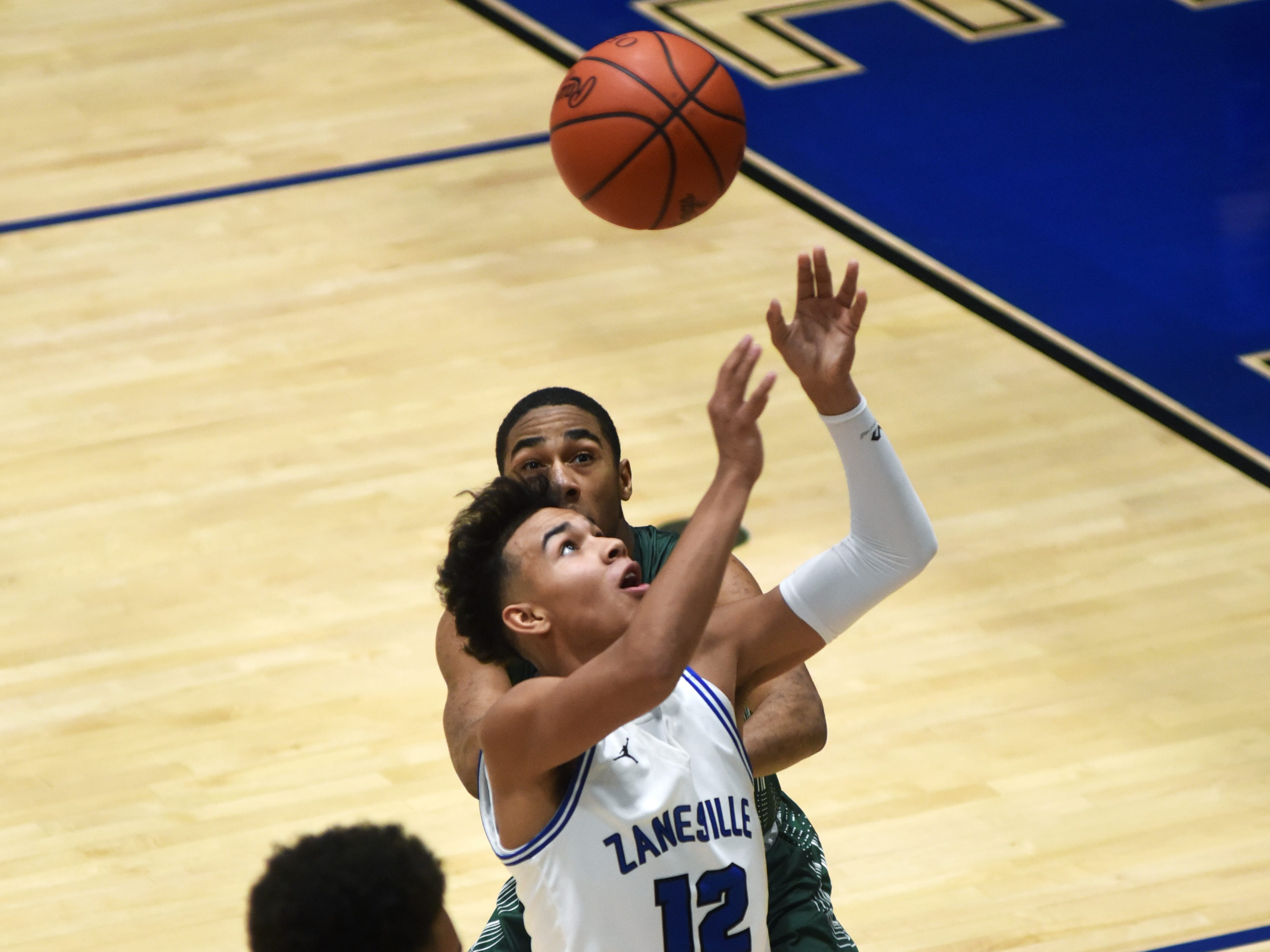 Cory Norris tries to corral a pass during Zanesville's 52-42 loss to Canton Central Catholic.