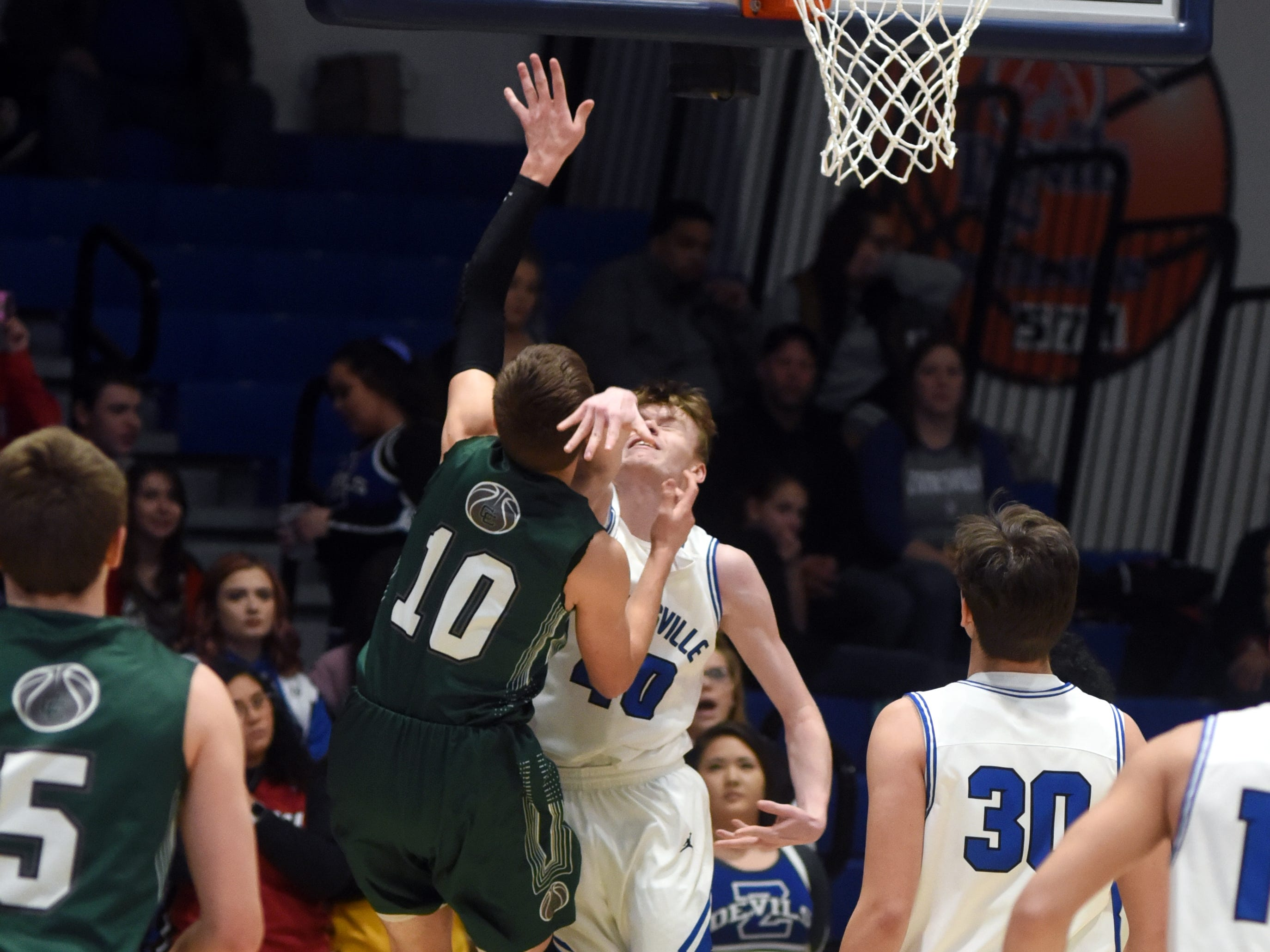 Canton Central Catholic's Dylan Johnson draws contact from Zanesville's Brennan Reasoner during the first half.