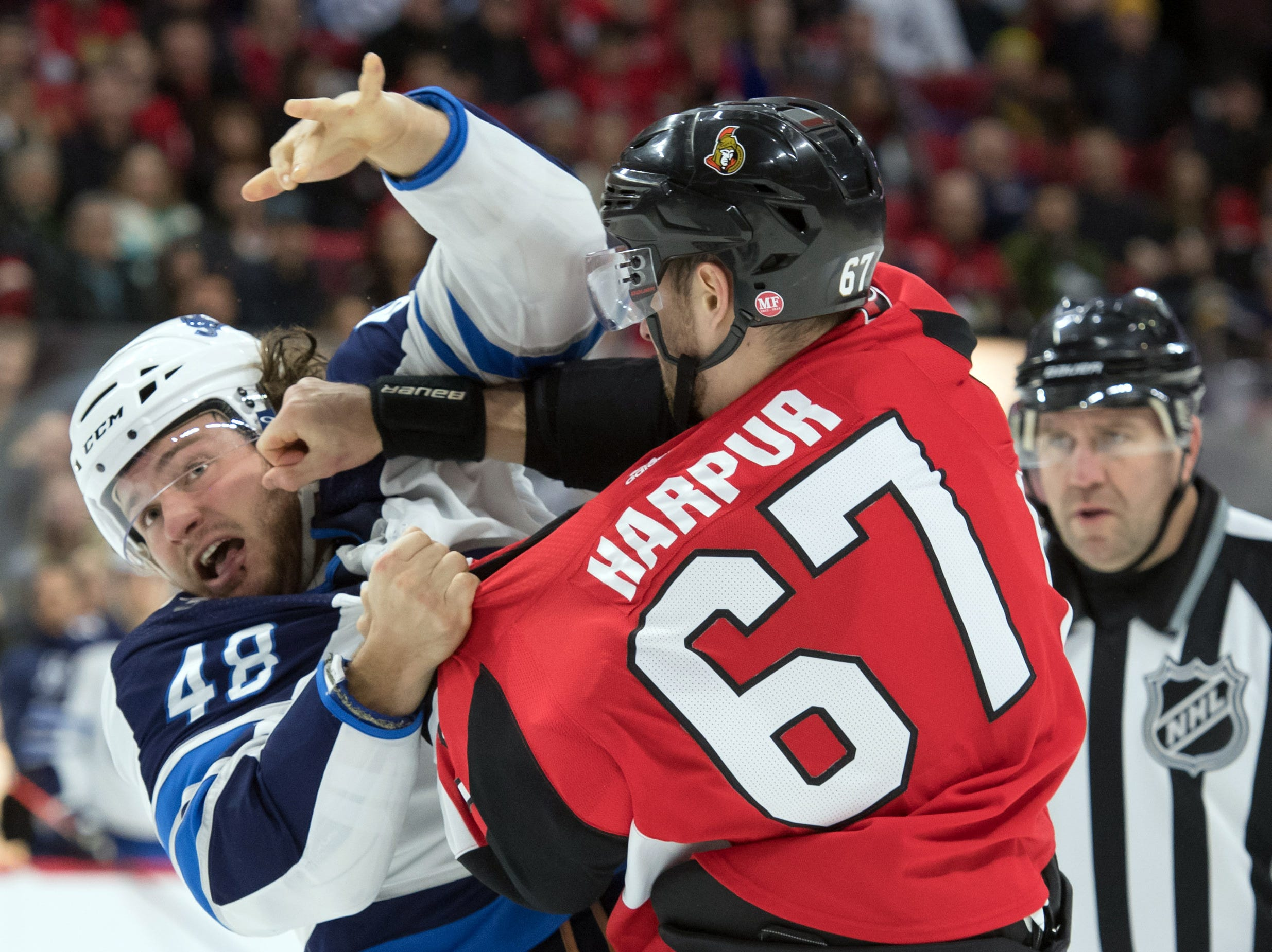 Feb. 9: Winnipeg Jets' Brendan Lemieux vs. Ottawa Senators' Ben Harpur