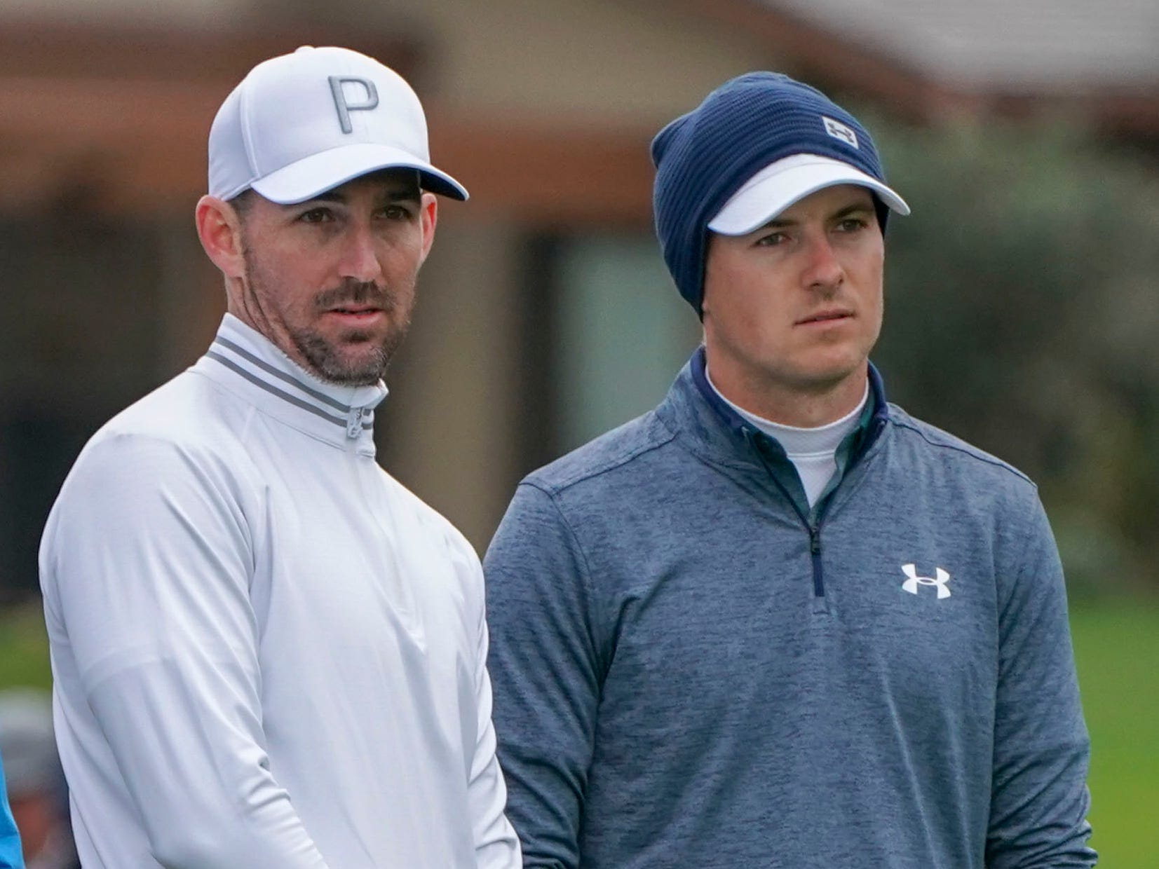 Singer Jake Owen (left) and Jordan Spieth (right) stand on the first hole during the final round of the AT&T Pebble Beach Pro-Am.