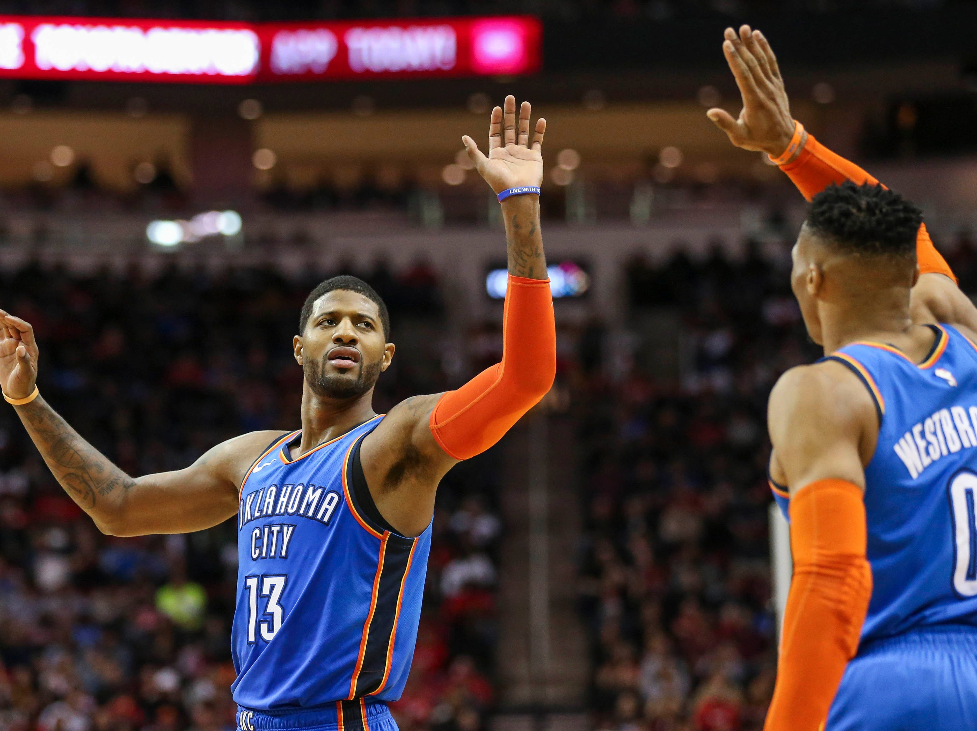 Feb. 9: Oklahoma City Thunder forward Paul George (13) celebrates with guard Russell Westbrook (0) after a play during the fourth quarter against the Houston Rockets at Toyota Center.