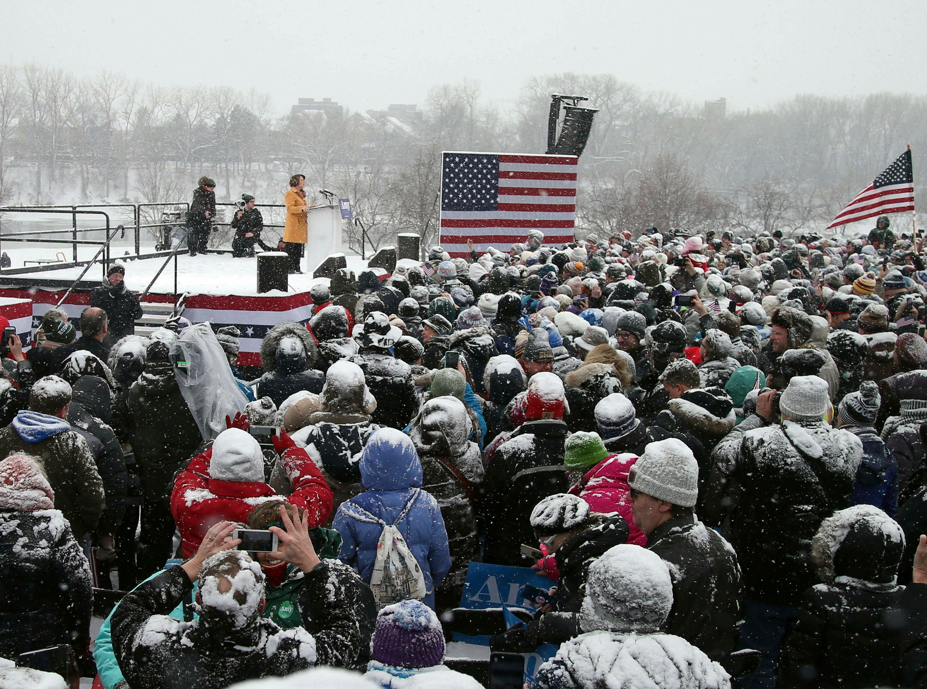 Democratic Sen. Amy Klobuchar, left, addresses a snowy rally where she announced she is entering the race for president Sunday, Feb. 10, 2019, at Boom Island Park in Minneapolis.