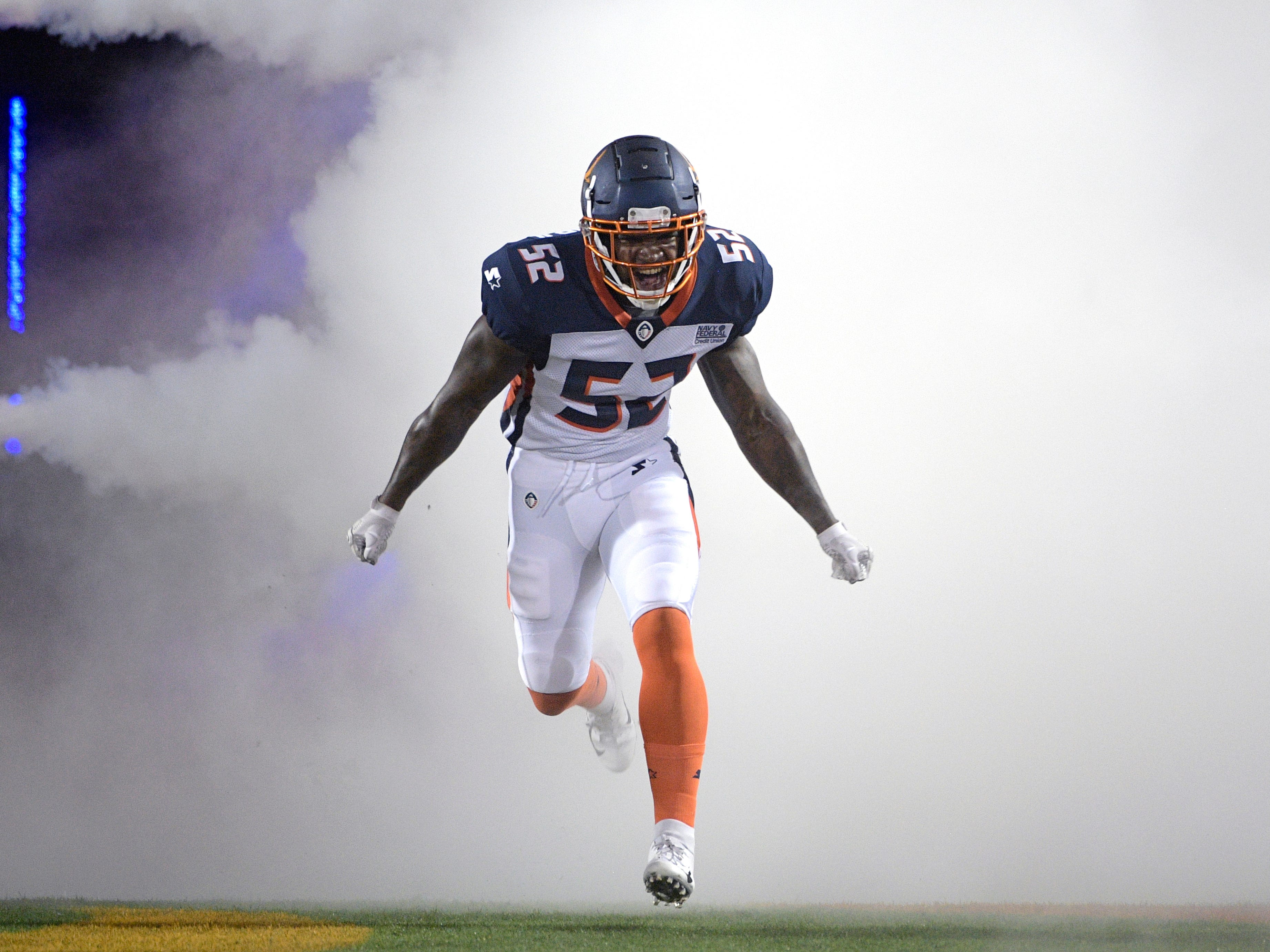 Orlando Apollos linebacker Reggie Northrup II runs onto the field during player introductions before an AAF  game against the Atlanta Legends  in Orlando.