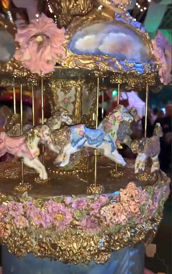 This working carousel Cake was made by Julie Simon Cakes for Stormi Webster's first birthday party.