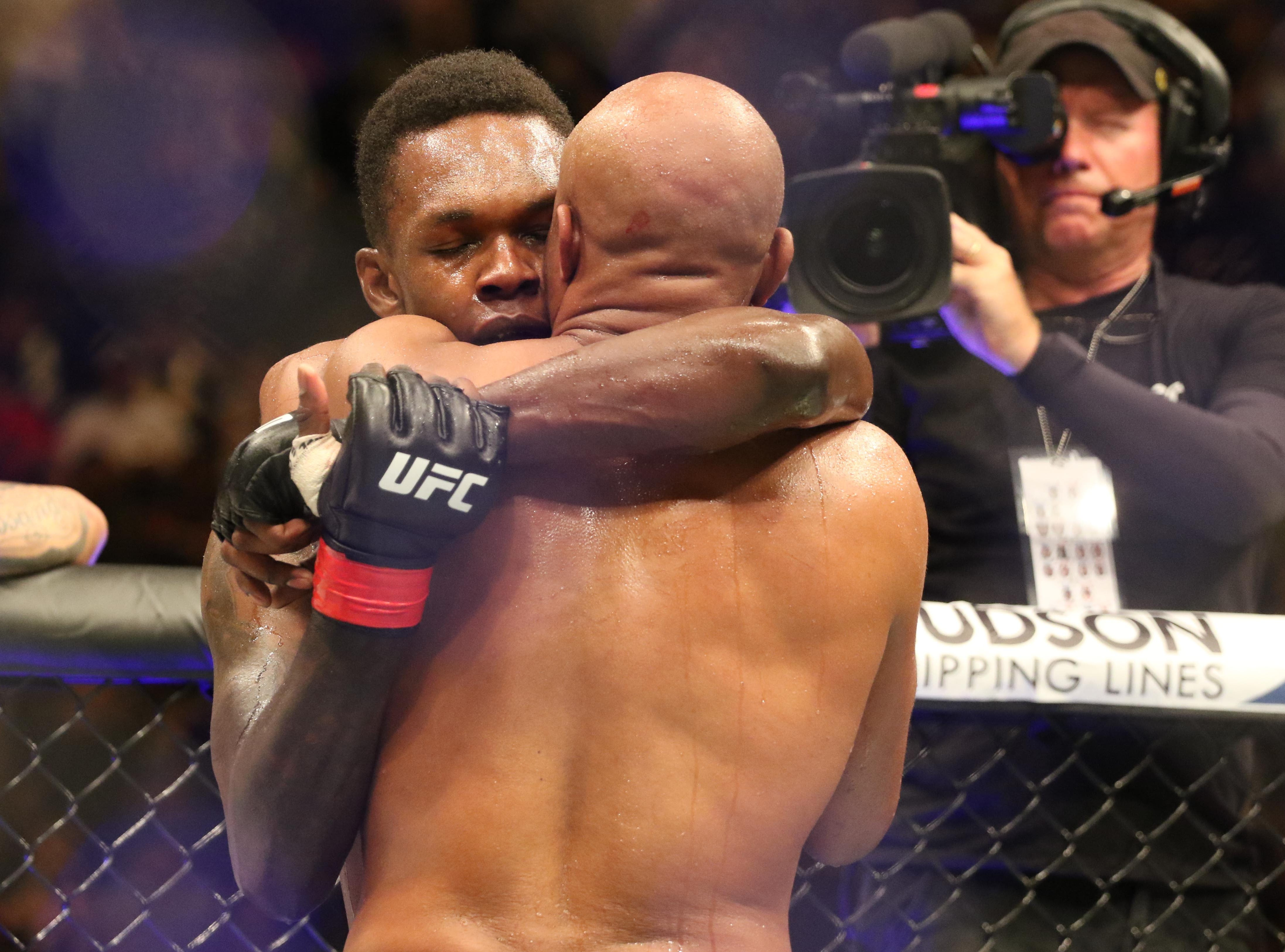 Israel Adesanya (red gloves) defeats Anderson Silva (blue gloves) during UFC 234 at Rod Laver Arena.