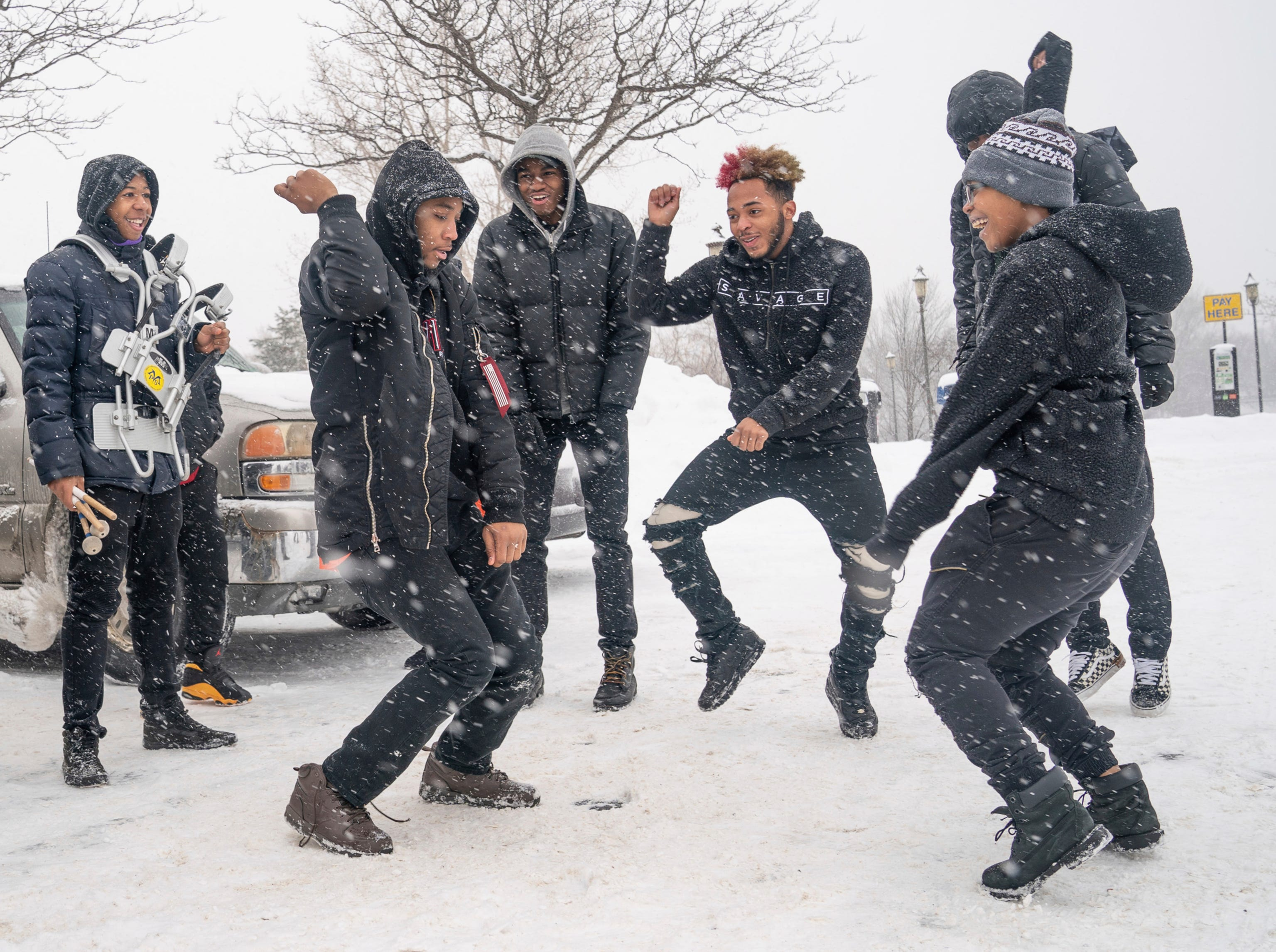 The combined North and Patrick Henry High School drum corps keeps warm in the parking lot Sunday, Feb. 10, 2019, before taking part in Sen. Amy Klobuchar's announcement to run for president from a snowy Boom Park, in Minneapolis.