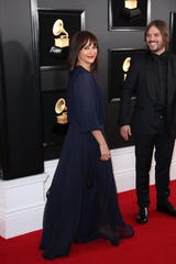 Rashida Jones and Alan Hicks arrive at the Grammy Awards.