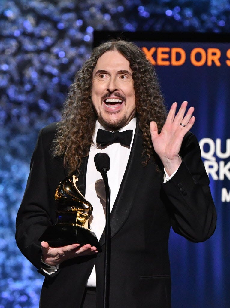 Unfamiliar Al Yankovic accepts the award for Most productive Boxed Or Special Little Edition Package for his