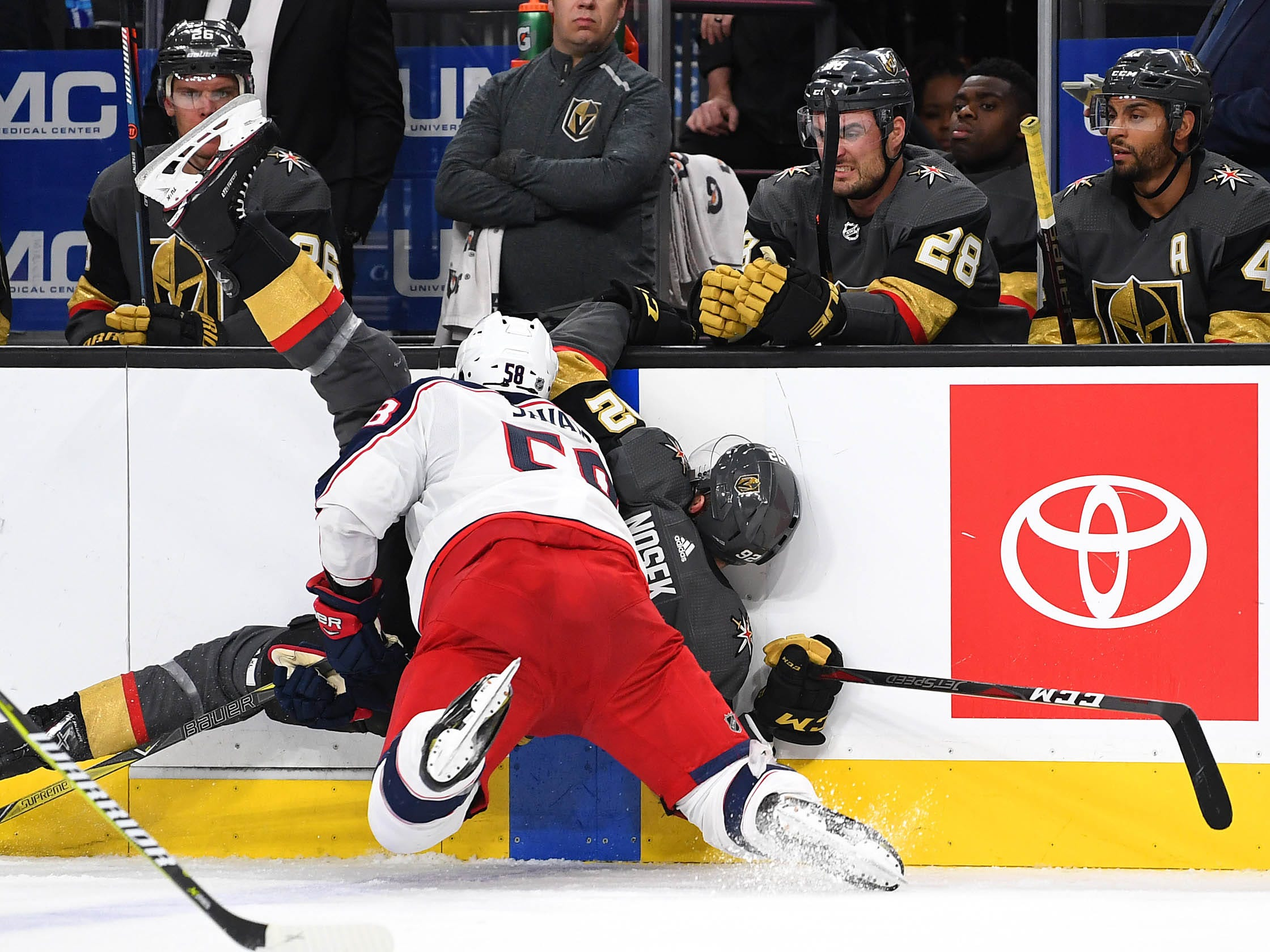Feb. 9: Columbus Blue Jackets defenseman David Savard checks Vegas Golden Knights left wing Tomas Nosek into the boards during the second period at T-Mobile Arena.