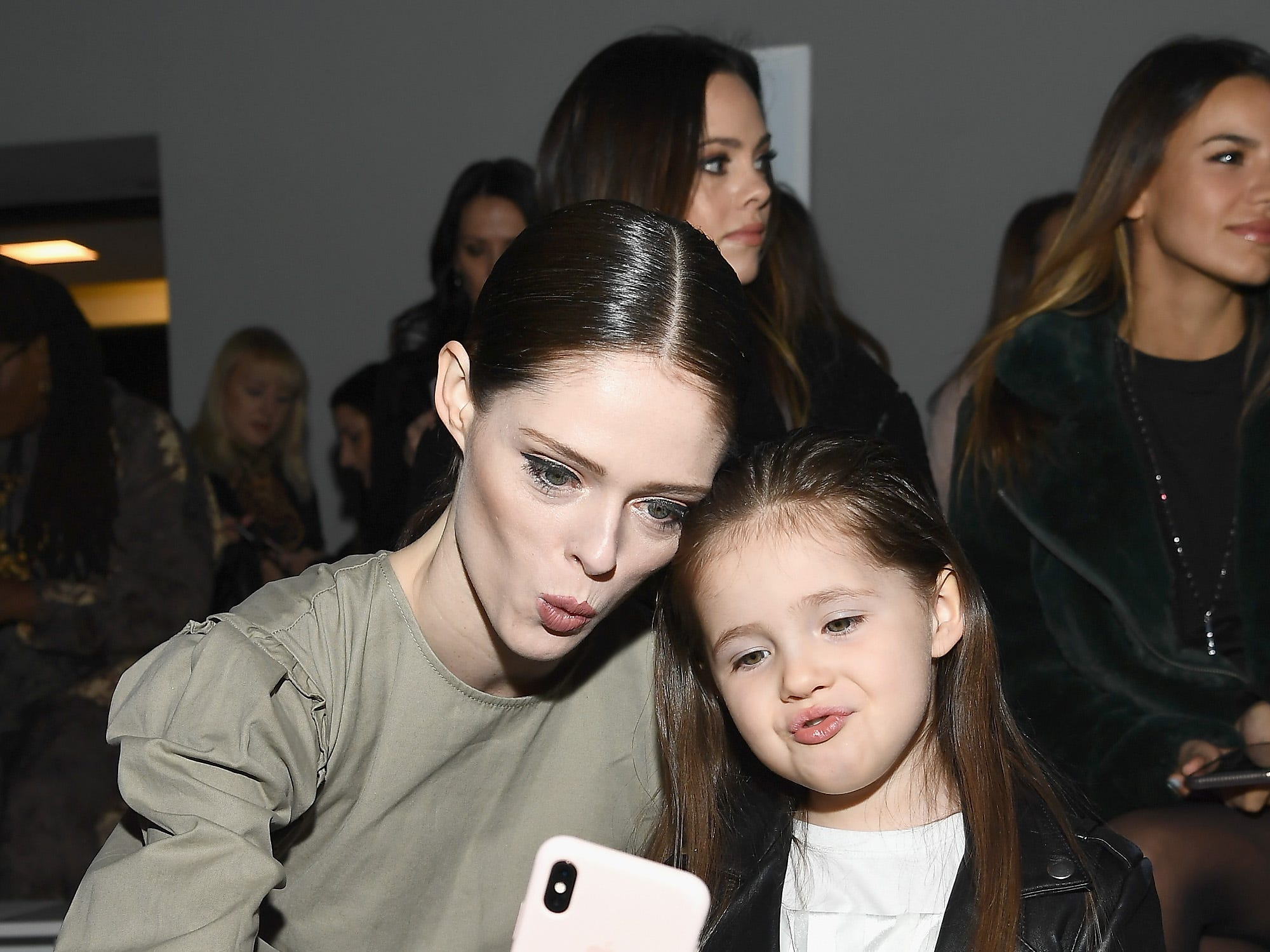 NEW YORK, NY - FEBRUARY 10:  Model Coco Rocha and her duaghter Ioni James Conran attend the Rebecca Minkoff front row during New York Fashion Week: The Shows at Gallery I at Spring Studios on February 10, 2019 in New York City.  (Photo by Dimitrios Kambouris/Getty Images for NYFW: The Shows) ORG XMIT: 775290845 ORIG FILE ID: 1097089338