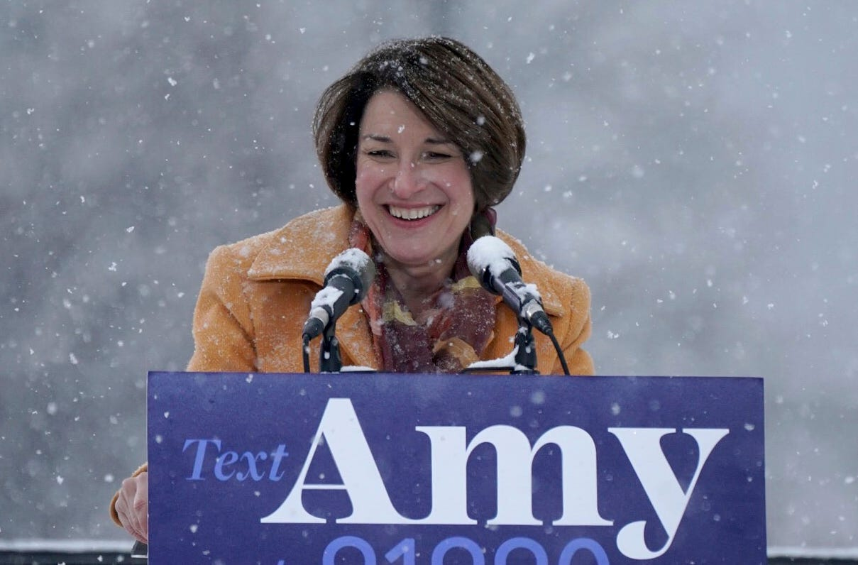 Sen. Amy Klobuchar greets the crowd before announcing her bid for president at Boom Island Park in Minneapolis, Feb. 10, 2019.