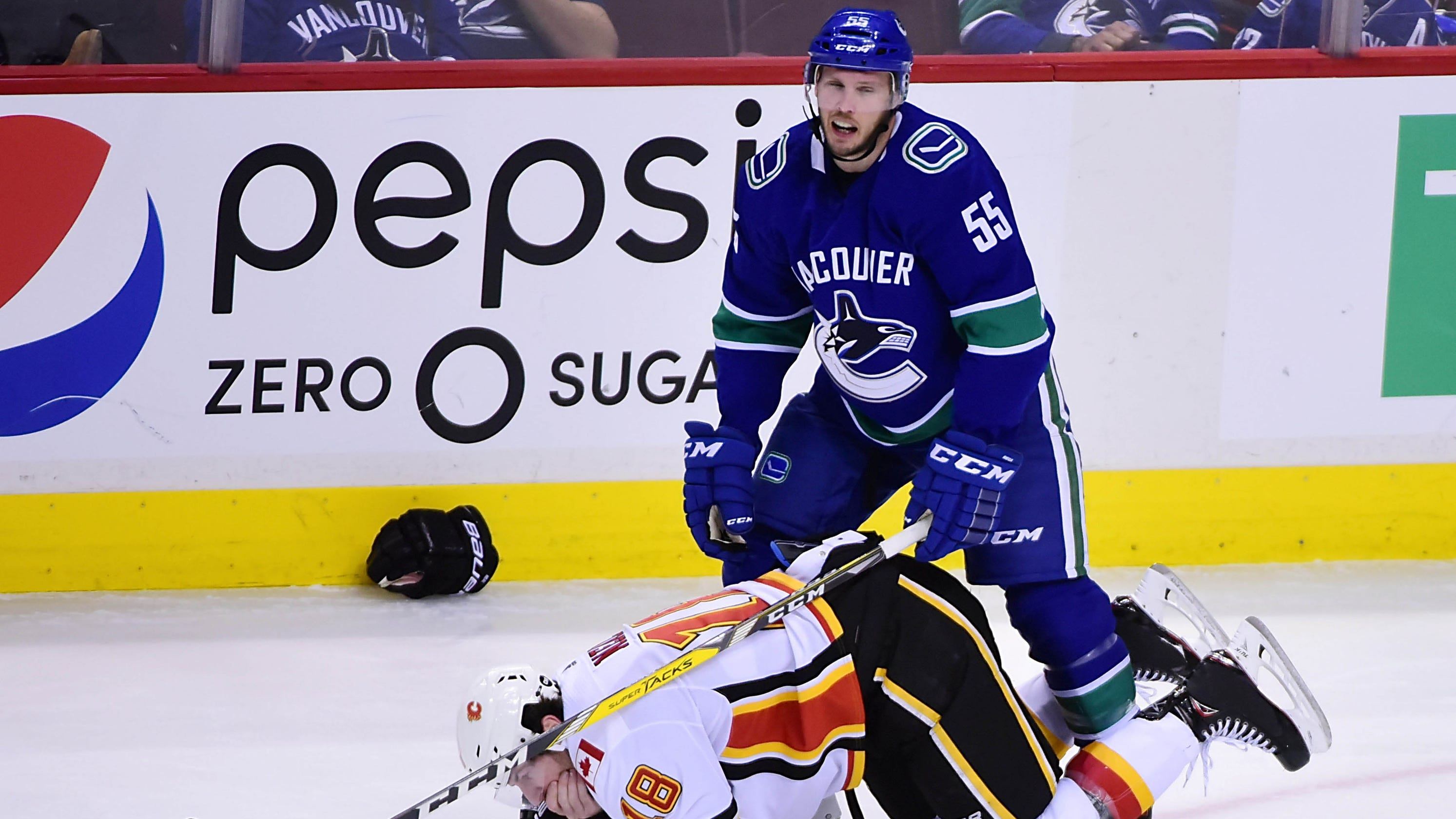 James Neal  Teeth go flying after Flames forward is hit by stick 60dbe1311