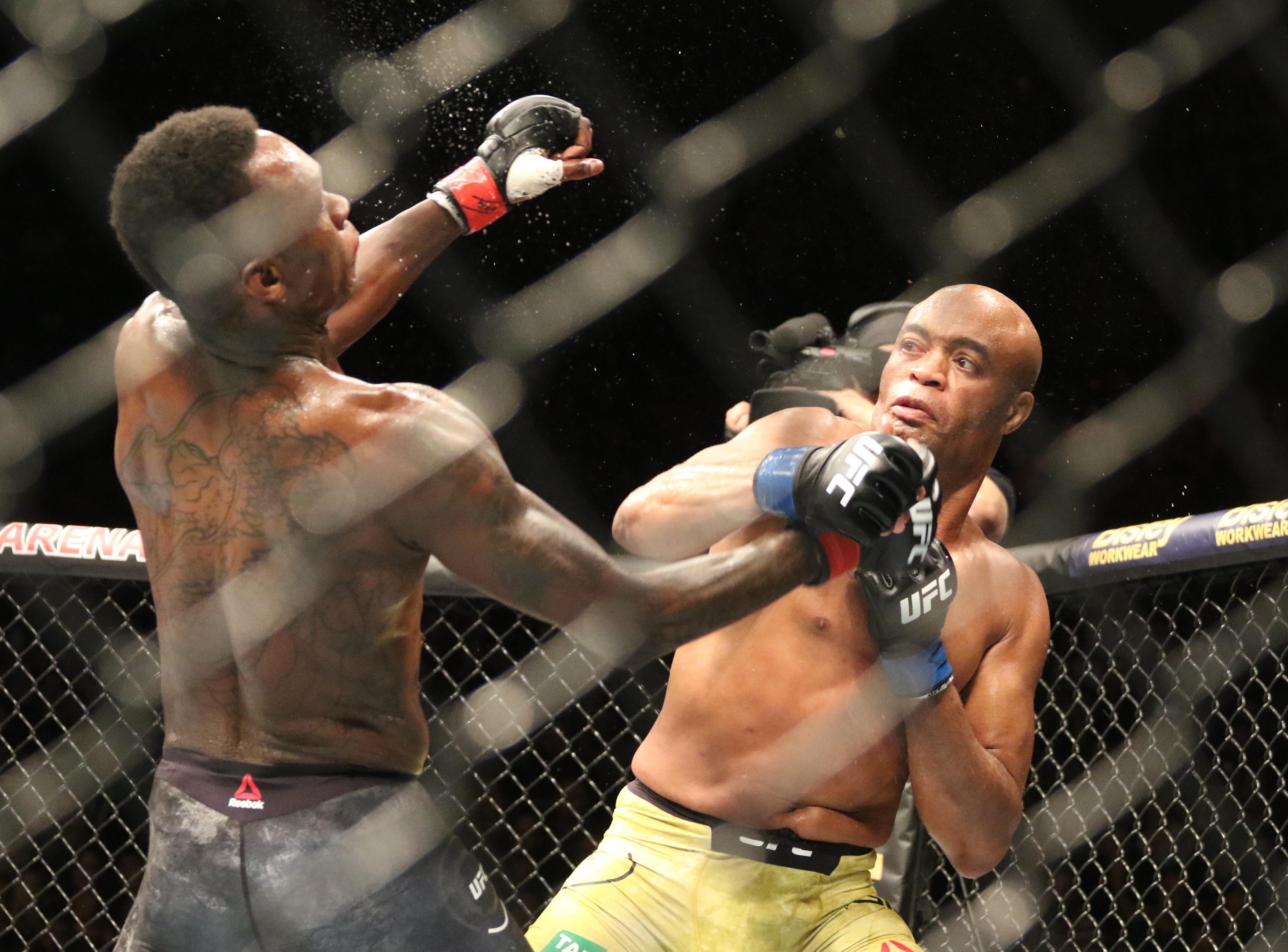 Israel Adesanya (red gloves) and Anderson Silva (blue gloves) fight during UFC 234 at Rod Laver Arena.