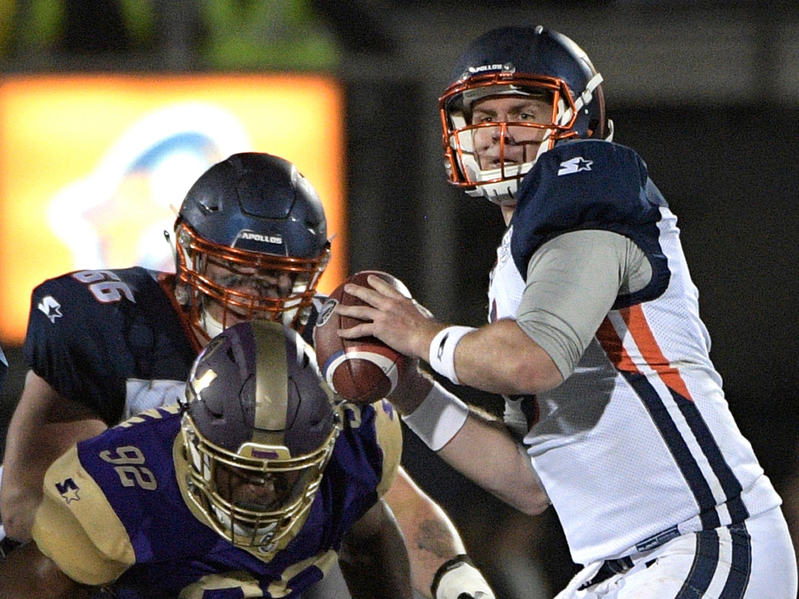 Orlando Apollos quarterback Garrett Gilbert sets up to throw a pass against the Atlanta Legends.