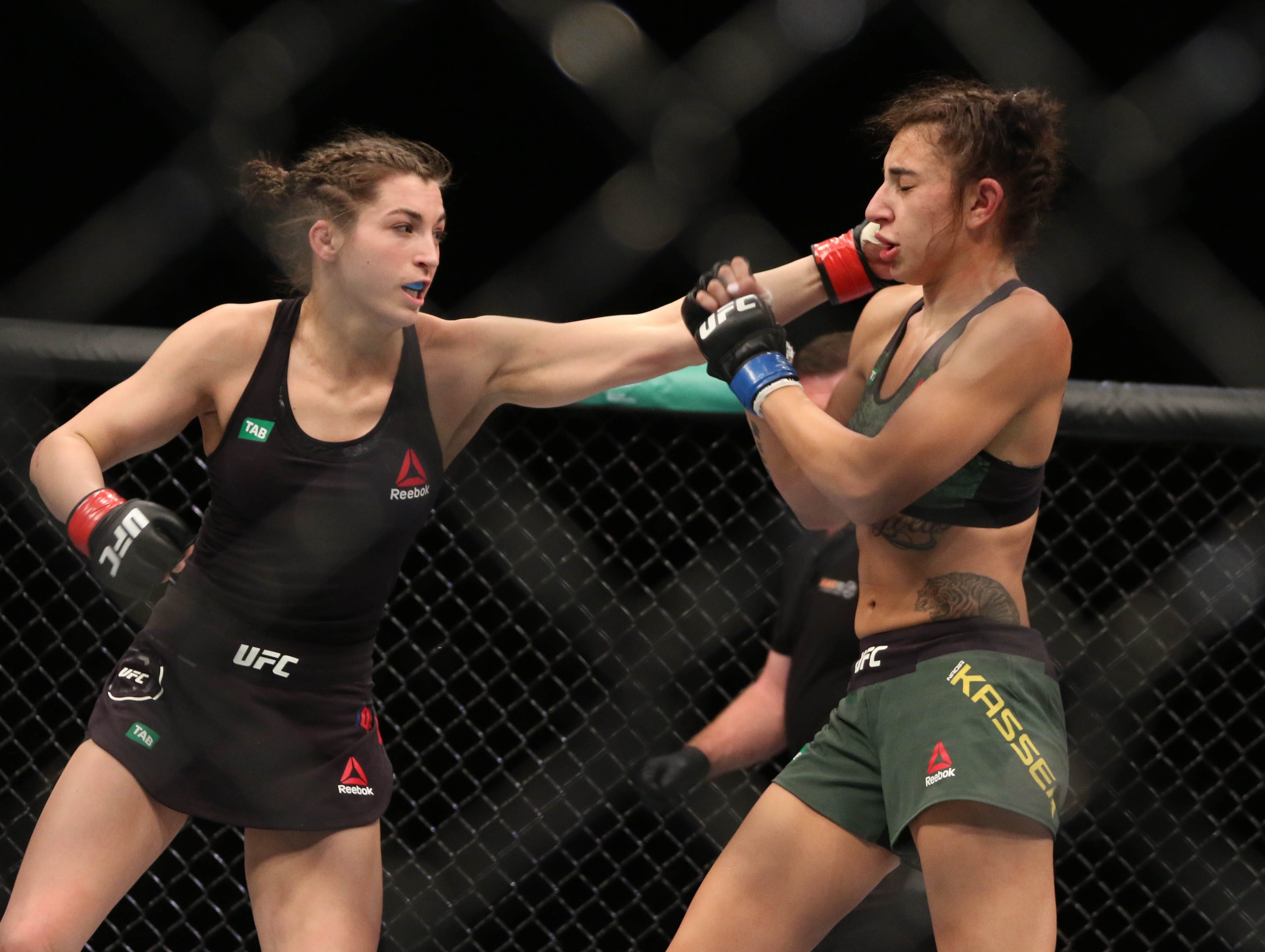 Montana De La Rosa (red gloves) and Nadia Kassem (blue gloves) fight during UFC 234 at Rod Laver Arena.