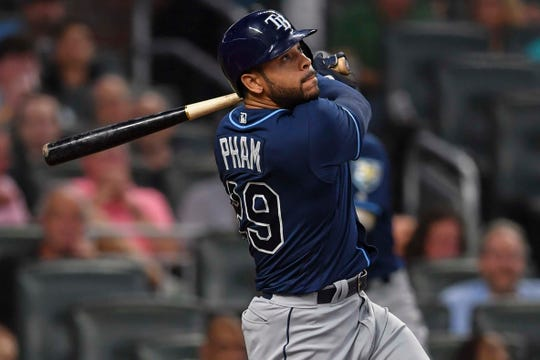 Tampa Bay Rays left fielder Tommy Pham (29) hits a two run home run against the Atlanta Braves.