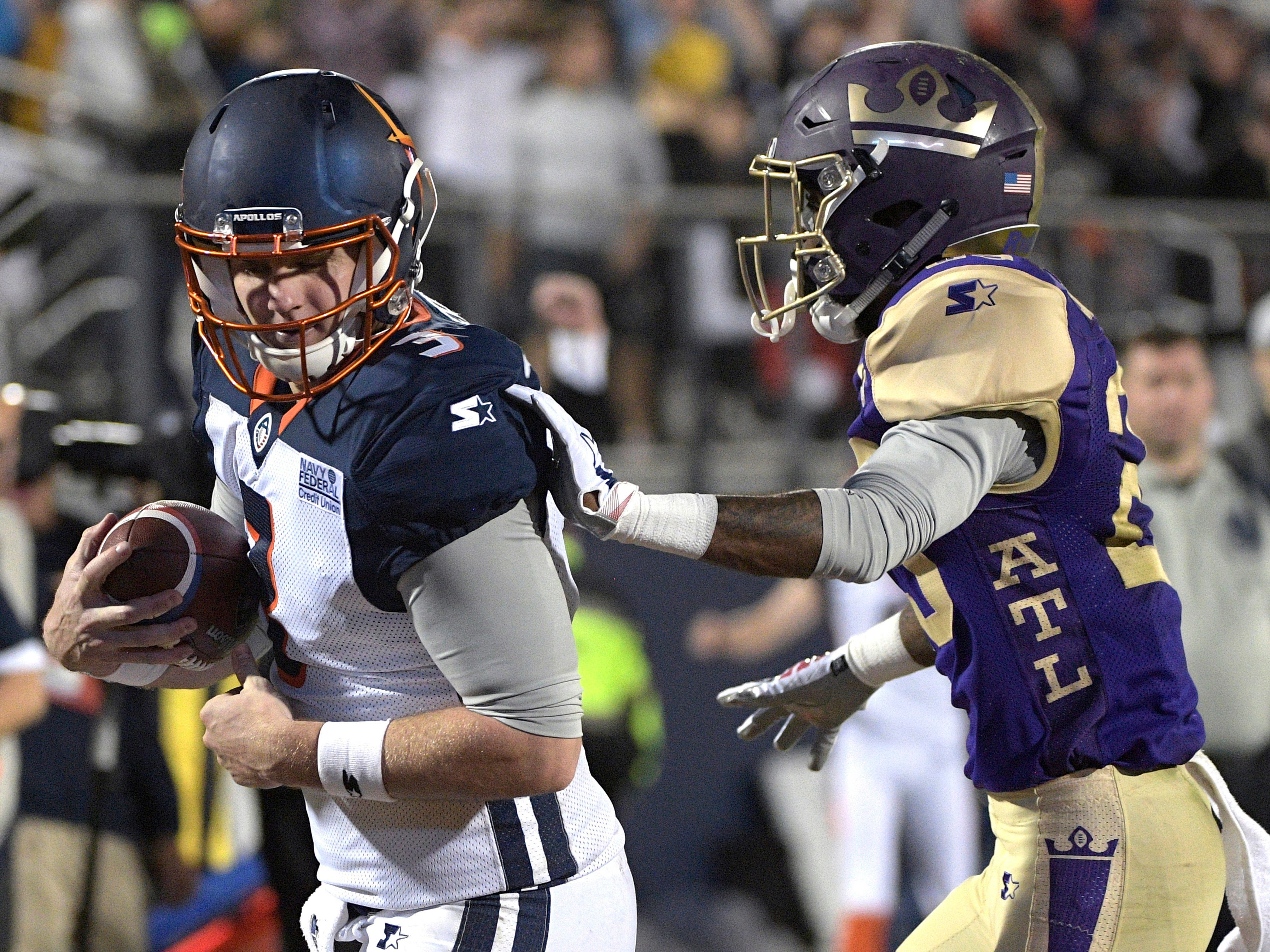Orlando Apollos quarterback Garrett Gilbert catches a pass from receiver Jalin Marshall for a 5-yard touchdown in front of Atlanta Legends defensive back Damian Swann.