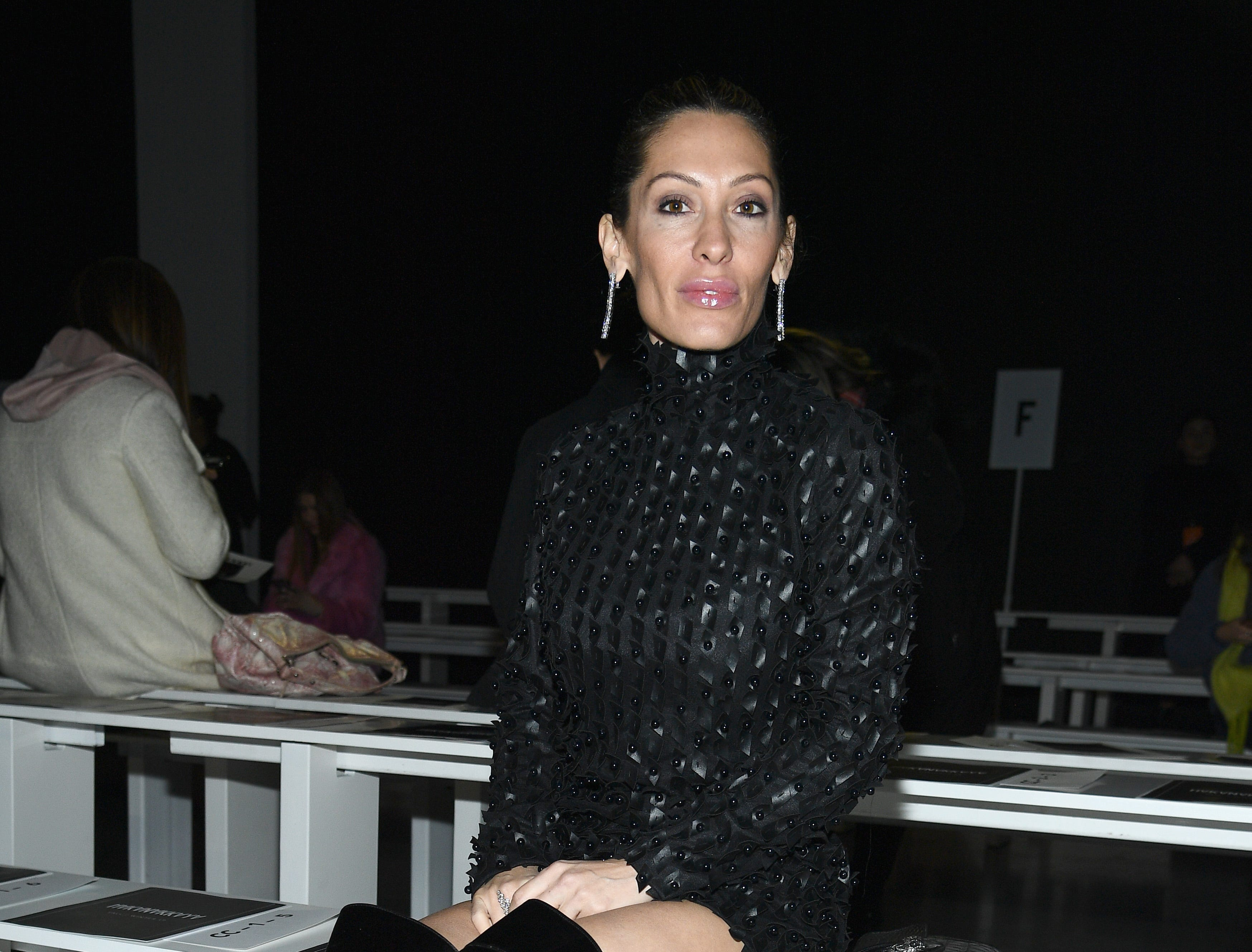 Seren Shvo is spotted sitting front row at Hakan Akkaya's fashion show.