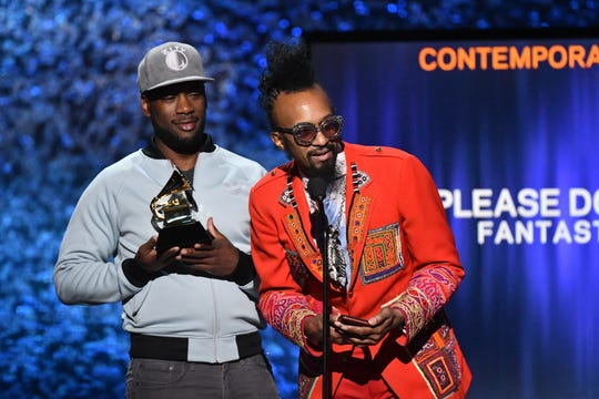 "Fantastic Negrito, right, accepts the award for best contemporary blues album for ""Please Don't Be Dead"" at the Grammy Awards Premiere Ceremony in Los Angeles."