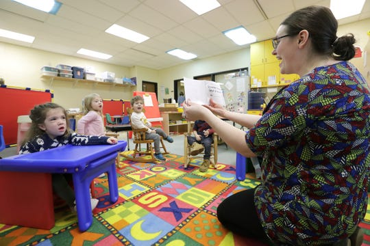 Avi Brennan, left, answers a question from speech-language pathologist Deirdre Floros during a speech therapy session Jan. 7 at the Washington School of Early Learning in Neenah. Avi has an undiagnosed form of skeletal dysplasia — a type of dwarfism — but recently began walking and attending school.