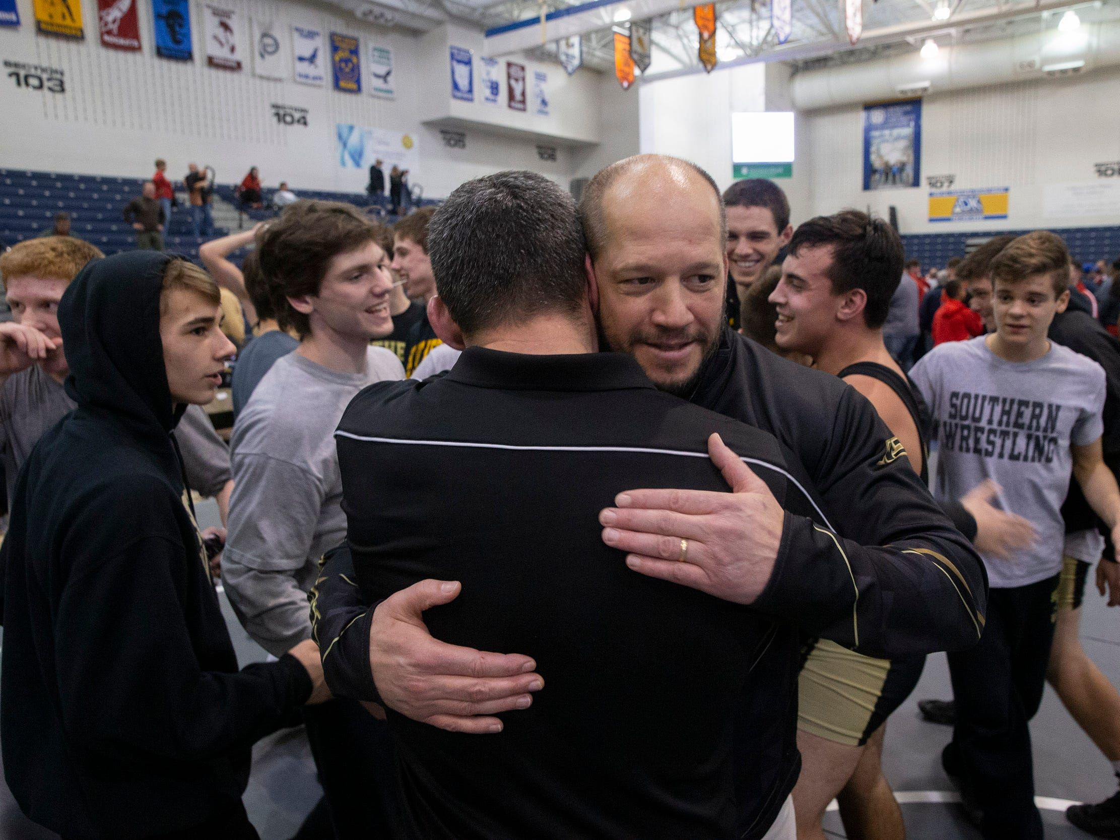 Southern Coach John Stout hugs one of his coaches after their win. Southern Regional defeats  Hunterdon Central 34-27 in NJSIAA Team Wrestling Group V Final in Toms River NJ on February 10 , 2019.