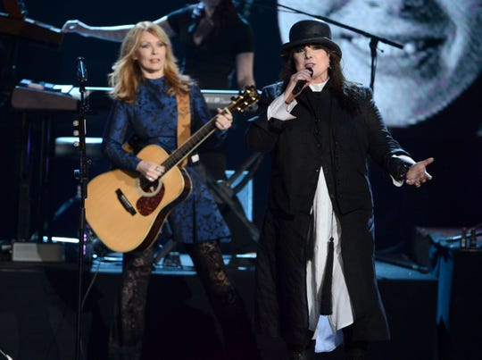 Inductees Nancy Wilson, left, and Ann Wilson of Heart perform on stage at the 28th Annual Rock and Roll Hall of Fame Induction Ceremony at Nokia Theatre L.A. Live on April 18, 2013 in Los Angeles, California.