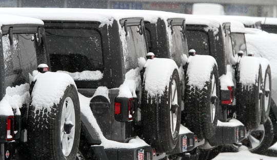Snow clings to the spare tires on Jeeps along Route 88 in Lakewood Monday morning, February 11, 2019.