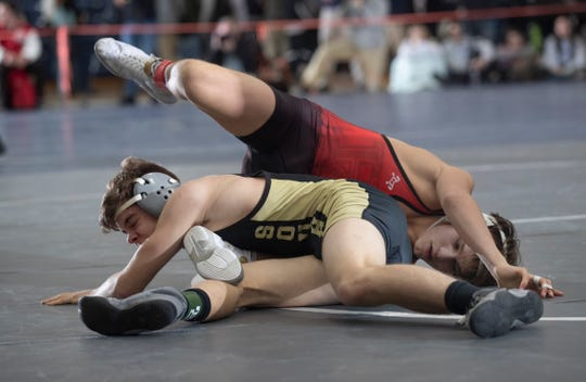 Hunterdon Central's Colton Washleski defeats Southern's Matt Brielmeier in their 120 lbs. bout.  Southern Regional vs Hunterdon Central in NJSIAA Team Wrestling Group V Final in Toms River NJ on February 10 , 2019.