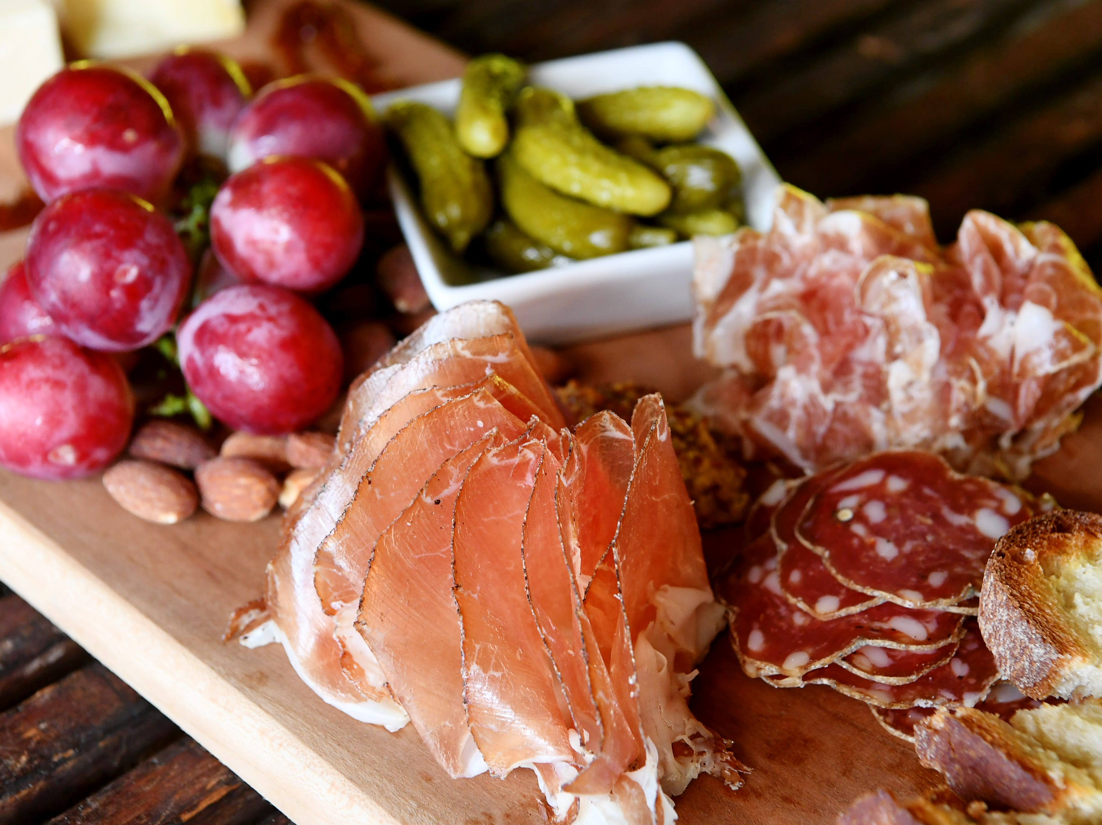 An assortment of charcuterie and cheese at District Wine Bar in the River Arts District Feb. 7, 2019.