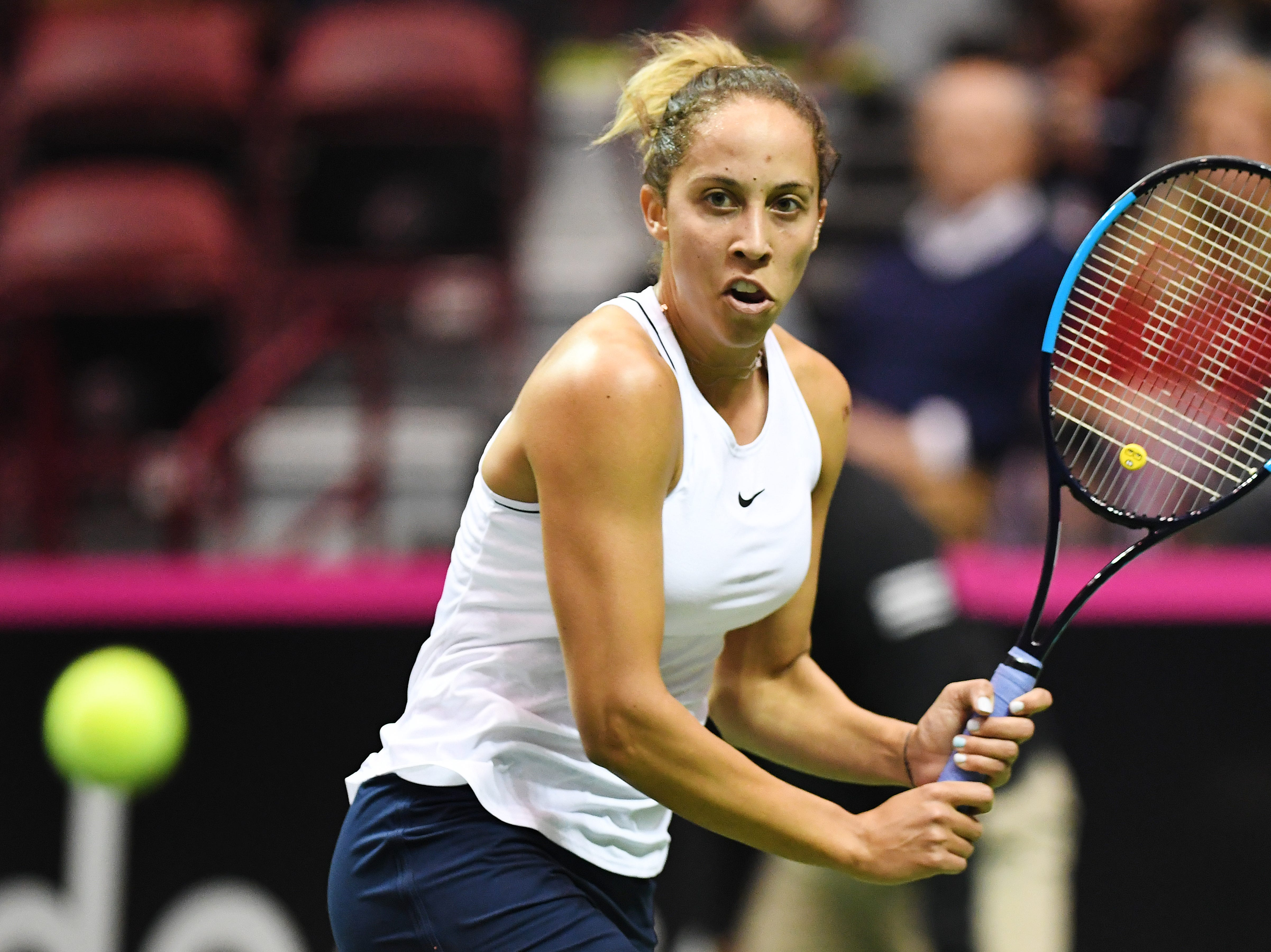 Team USA's Madison Keys prepares to return the ball in her match against Australia's Ashleigh Barty in the first round of the Fed Cup at the U.S. Cellular Center on Feb. 10, 2019.