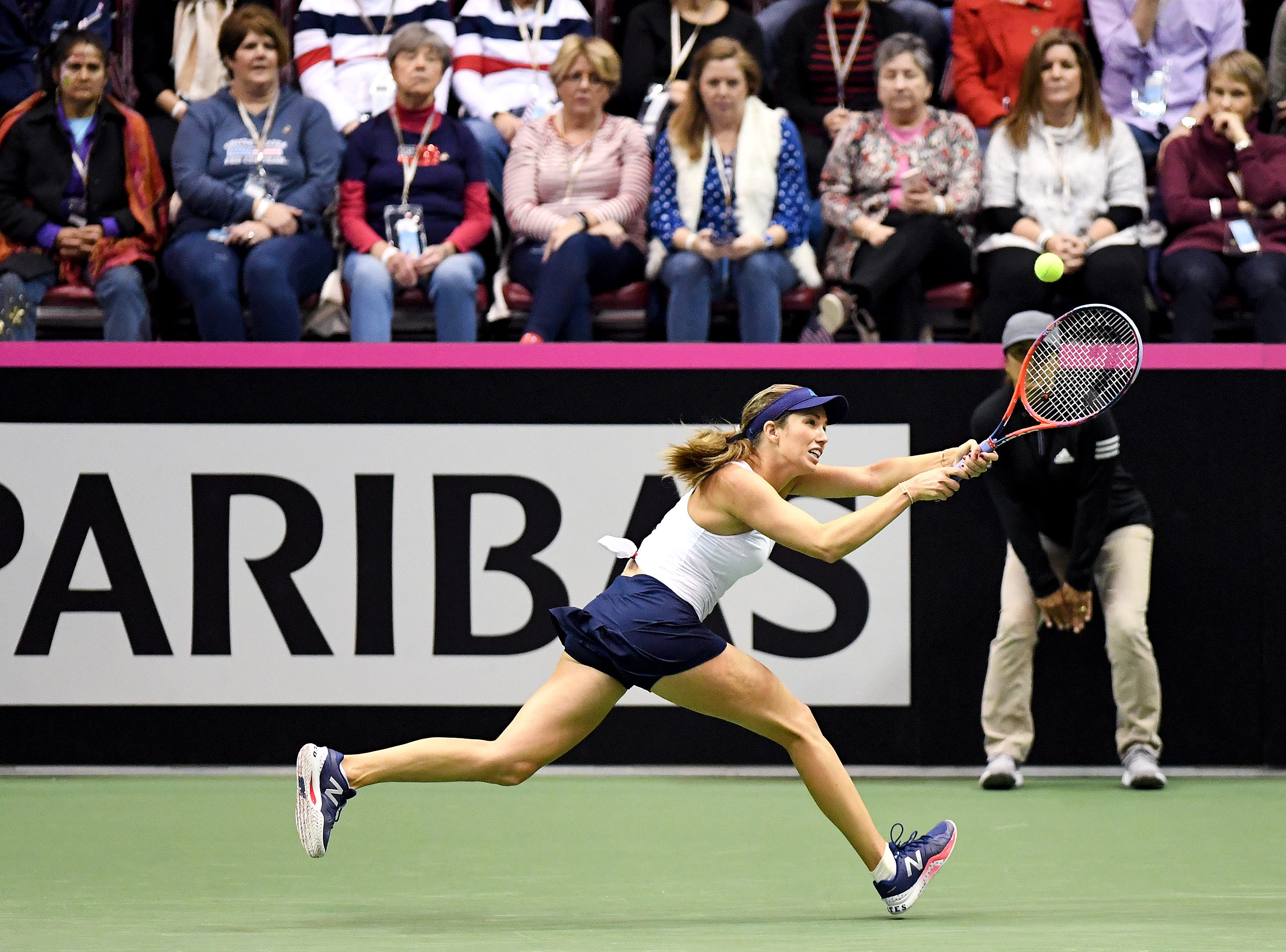 Team USA's Danielle Collins runs after the ball to return it  during her match against Team Australia's Daria Gavrilova in the first round of the Fed Cup at the U.S. Cellular Center on Feb. 10, 2019.