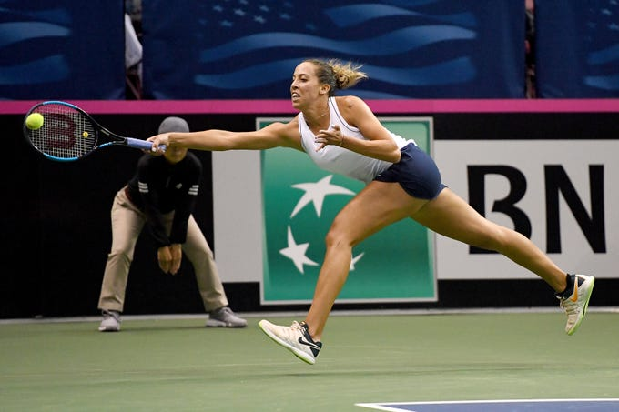 Team USA's Madison Keys stretches after the ball in her match against Australia's Ashleigh Barty in the first round of the Fed Cup at the U.S. Cellular Center on Feb. 10, 2019.
