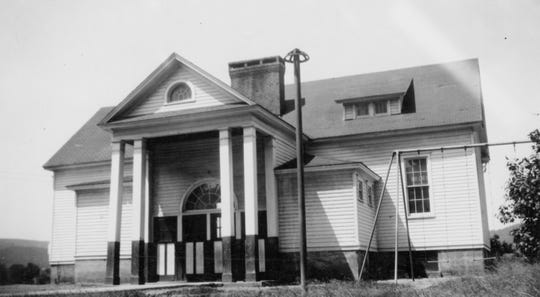 A two-room schoolhouse, now home of the Kirkwood Historical Society, about 1950.