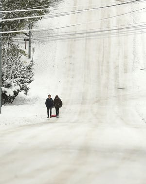 A sled is pulled down a snow-covered 15th street in Bremerton on Monday, Feb. 11, 2019.