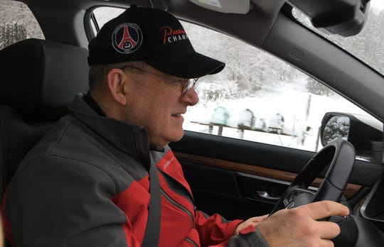 South Kitsap School District Transportation Director Jay Rosapepe drives a road in South Kitsap on Monday following back-to-back snow storms over the weekend.