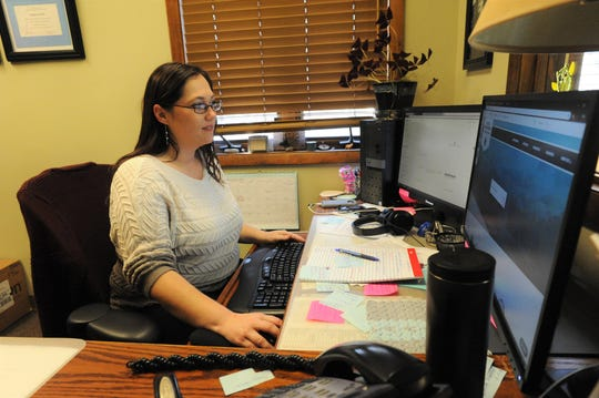 Town clerk Angela Reece works on the town's new website, which launches Feb. 25.