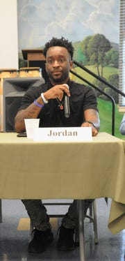 Jordan, one of the youth in Black Mountain Home for Children's independent living program, talks about his experiences at the home during an open forum on Feb. 7.