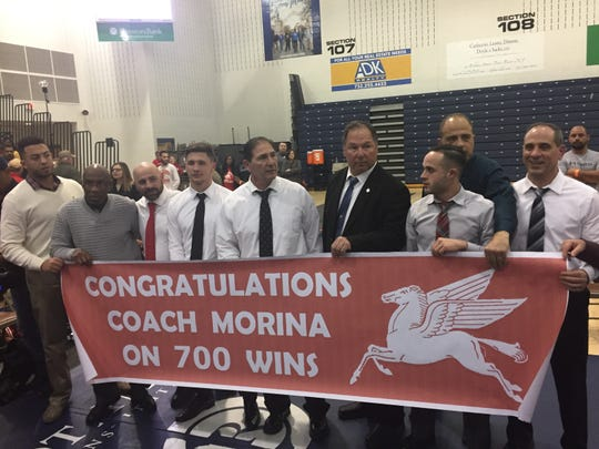 Paulsboro coach Paul Morina, fourth from left, won his 700th career match Sunday night.