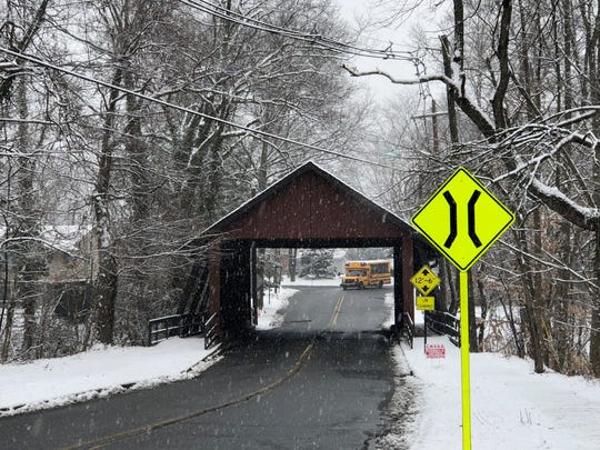Light snow falls Monday morning on Covered Bridge Road in Cherry Hill.