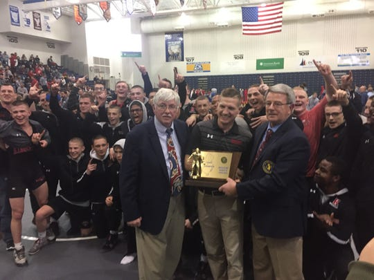 The Kingsway High School wrestling team celebrates its state Group 4 title. Front (left to right): Howie O'Neil, Kingsway coach Mike Barikian and Jack Kinner.